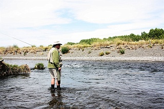 New Zealand fishing guide Grant Petherick in his office, eyeballing this pool on the Tukituki River for trout