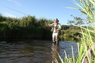 Waders, a fising hat and UV protection shirts round out an angler's outfit