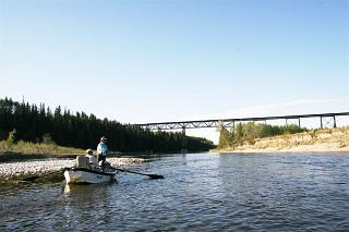 Angling from a drift boat on the Red Deer River