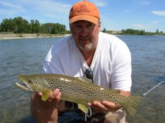 Perry McCormick with a hefty brown trout