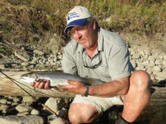A fine Bow River rainbow trout comes to the net