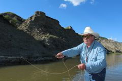 Casting a flyrod for grayling in the Red Deer River badlands