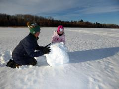 Building a snowman with Grammy.