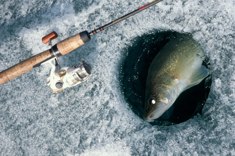 Ice fishing strategy 2 going light fishing article by for Ice fishing hole